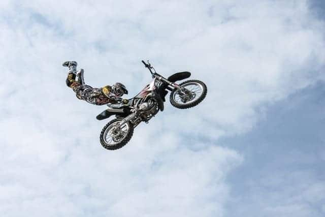 Daredevil Leadership, person doing death-defying tricks on a motorbike