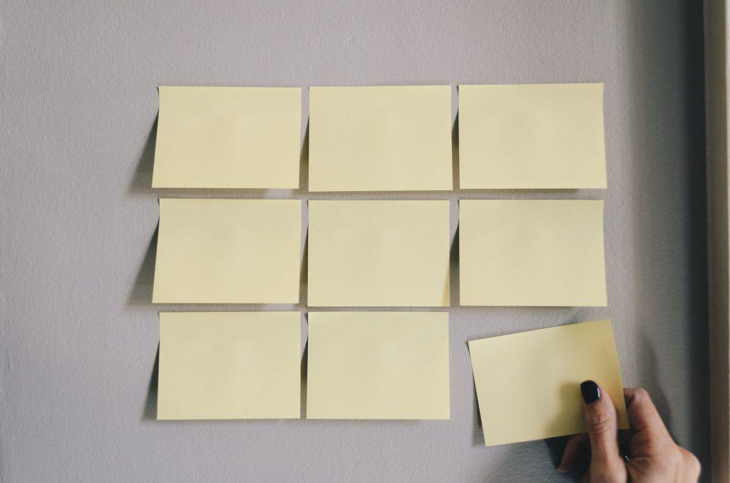 Post it notes on a wall are shown with one being taken off a wall. 75/25 Rule: Reminding vs. Teaching