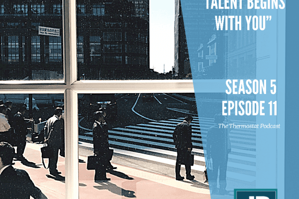 Season 5 Episode 11: Attracting Talent Begins With You (us). A window view that looks out into a corporate jungle with people in suits holding briefcases waiting for something to happen.